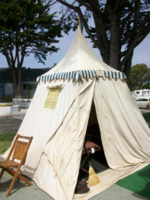 Old tent parked outside of one of the trailers