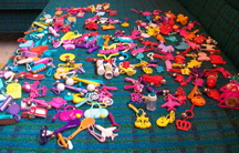 charms organized by like category on my couch