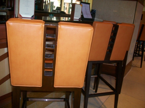 Orange leather chair at the bar