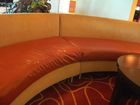 Two shades of orange couch